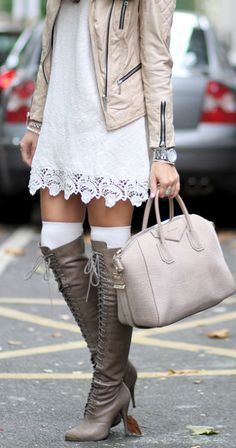 Sweet dress paired with a white coat and amazing lace up boots
