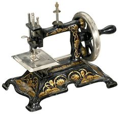 Did you have a 'toy' sewing machine when you were little?  Did it work for real?  This pretty antique German toy sewing machine is exactly like one we had when I was a little girl.  I didn't sew on it for real, but I pretended :)