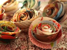 Cute paper roses. Would be great for wrapping decor, instead of bows!