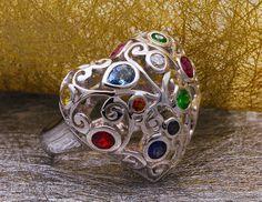 "Garden of gems. Alexandrite, aquamarine, demantoid, diamond, ruby, spessartite, tsavorite and fancy sapphires swirled in this 14K white gold ""Parterre"" ring."