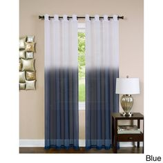 The Essence lined window curtain panel features a semi sheer ombre color that will complement your contemporary styled home. The curtain panel has a grommet top for easy hanging. The ombre print comes