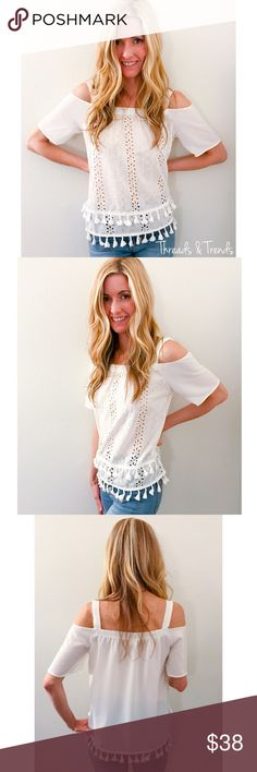 Tassels & Eyelet Blouse Adorable design, Strappy cold shoulder blouse with white eyelet detail and trending tassels. Made of a cott/spandex/poly blend. Size S, M, L Threads & Trends Tops Blouses