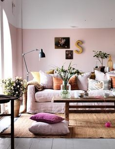 Love this, but maybe different colors. Love the wall decor, plants and pillows. Pattern?