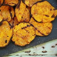 Grilled Spicy Sweet Potato Chips | Grilled sweet potato chips with chile powder, garlic, and cumin are a spicy and sweet snack or accompaniment to grilled burgers for summer barbecues.