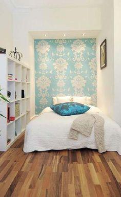 Kinda like this low to the ground bed and big white storage/bookshelf unit