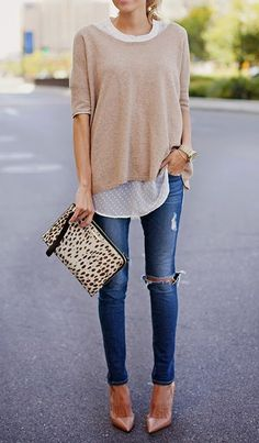 Distressed skinny jeans + layers.