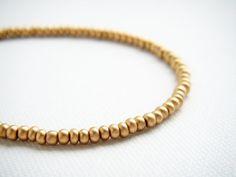 Gold satine tiny beaded bracelet friendship by juditpukkai Use coupon code on Etsy: PIN10 to get 10% discount :-) Beaded Jewelry, Handmade Jewelry, Beaded Bracelets, Unique Jewelry, Handmade Gifts, Pj, Coupon Codes, Friendship Bracelets, Bangles