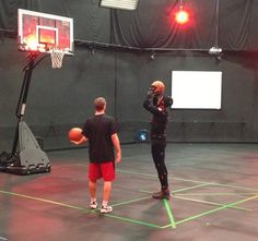 """Weber State alumnus Damian Lillard wears a motion capture suit for EA Sports' NBA Live 2014. He's definitely """"in the game."""""""