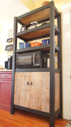 Kitchen cabinet and shelving, with reclaimed barn wood doors and shelves. Knobs from Bushere and Son Iron Studio.