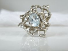 The genuine blue topaz gemstone is exotic in this incredible sterling silver handmade ring. SIZE: 7 can be sized by a professional jeweler. This ring is studio made piece. Sterling Jewelry, Gemstone Jewelry, Sterling Silver, Hand Cast, Topaz Gemstone, Brutalist, Wholesale Jewelry, Handmade Silver, Blue Topaz
