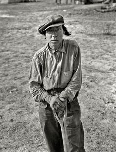 "February 1937. Calipatria, California. Native of Indiana in a migratory labor contractor's camp. ""It's root hog or die for us folks."" Large format negative by Dorothea Lange for the Resettlement Administration."