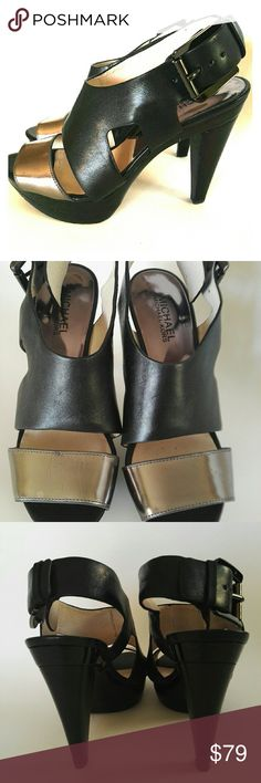 🛍Michael Kor Carla Platform Sandals Leather 7M This newly design by MK, very comfortable to wear. With dress , looks very stylish and classy. With jeans, has  enlongging legs effects, and looks very cool! Gently used. Very Good condition. Right shoe gunmetal leather has a little wrinkles, Leather has mini scratchers, hardly can tell. It will come with the original box, bought from Nordstrom. Michael Kors Shoes Sandals