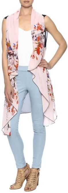 Two Chic Cherry Blossom Vest Was $30 Now $18 At Shoptiques Lightweight, long floral print vest open front high low hemline https://api.shopstyle.com/action/apiVisitRetailer?id=520564492&pid=uid841-37799971-81