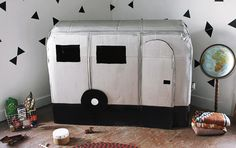 A camper playhouse and more all made out of cardboard.