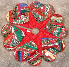 """Crazy Quilt Christmas Tree Skirt I made. This is from the book """"Merry Christmas Quilts""""."""