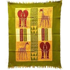 Batiked and painted by hand, this vertically-oriented barkweave cotton wall hanging has a unique herd of elephants and giraffes. It measures 29.5 by 39 inches (75cm X 1 M). Meet the Artisans Founded b