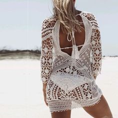 Christal Crochet Beach Dress - The Wild Flower Shop   In super breezy knit, this beach cover up is fabulous for your little getaways! The sheer feature is the perfect complement to laid-back days and perfect piece to show off your carefree spirit! • Open back feature •  Weight 150 gram Material: Knit Cotton blend   $22