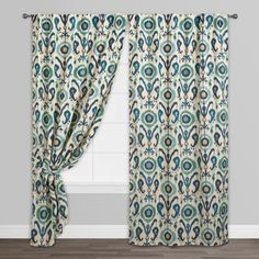 Featuring our exclusive, global-inspired design, these enchanting indigo and ivory curtains create a focal point with a bold ikat print. This fully lined curtain has a concealed tab top or sleeve top option, adding a nicely tailored look to any space.