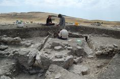 Excavating stone-built walls and drains on the northern edge of the village at Vagnari. Image: M. Carroll