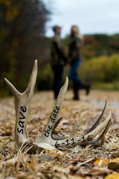 Deer antler engagement picture. Save the date. Engagement picture idea.