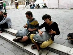 Street musicians playing some unusual instruments in Venice