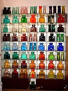 "Blenko glass PPS: ""wall of blenko. Mine is third row from the bottom, second from the right.Olive green love it"" Antique Bottles, Vintage Bottles, Bottles And Jars, Antique Glass, Vintage Glassware, Perfume Bottles, Water Bottles, Vintage Perfume, Water Carafe"