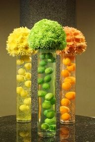 tissue flowers in top of tall cylinder - for podium, no fruit, just fish and colored water