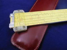 "Pickett N600 ES Log-Log Slide Rule, Vintage Slide Rule by Pickett with Leather Pocket Case Measures 3/4 in x 7 in x 2 in.  Science & Technology slide rule. Pickett & Eckel  Fun to own as this is the same type Model that went to  the moon and used by the Apollo astronauts.  Yellow eyesaver rule. Scales: LL1, A [B, ST, T, S, C]D, DI, K. Reverse: LL2, DF [CF, Ln, L, CI, C] D, LL3.  In maroon case with gold ""Pickett"" embossed on tab.  Good vintage condition with leather pocket case."