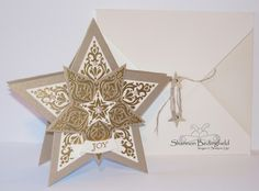 The envelope is out of Very Vanilla cs and uses Linen Thread, Itty Bitty Accents Star Punch, Mini Brads, and the Envelope Punch Board.