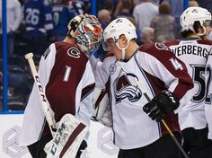 TAMPA, FL - OCTOBER 29: Goalie Semyon Varlamov #1 and Tyson Barrie of the Colorado Avalanche celebrate the win against the Tampa Bay Lightning at the Amalie Arena on October 29, 2015 in Tampa, Florida. (Photo by Mike Carlson/NHLI via Getty Images)