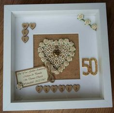 THANK YOU FOR VISITING MY PAGE YOU ARE BUYING AN 10 X 10 SCRABBLE ART FRAME IN WHITE THE BACKGROUND IS HESSIAN AND A CREAM FILAGREE AND MULBERRY ROSE HEART IS SET IN THE CENTER MR & MRS, MR & MR OR MRS & MRS AND YOUR CHOICE OF SURNAME HAND STAMPED ON WOODEN HEARTS, ROSE BUNTING, A GOLD HEART CHARM (designs may vary) PLUS A PERSONALISED TAG WITH YOUR CHOICE OF WORDS AND A GOLD TONE DIAMANTE 50 FINISHES THE FRAME. THIS IS A PEFECT ANNIVERSARY, WEDDING OR ENGAGEMENT GIFT FOR AN ENGAG...