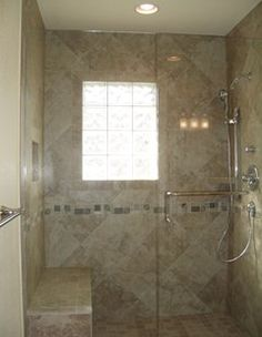 Photo On Custom tile work for a beautiful shower A glass block window and custom frameless shower