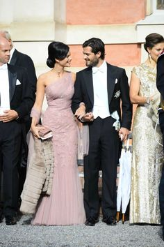 Swedish Royal Family Attends Wedding of Gustaf Magnuson-Sofia Hellqvist and her boyfriend Prince Carl Phillip of Sweden, along with Crown Princess Victoria, at the wedding of Princess Christina's son Gustaf Magnuson, August 31, 2013.