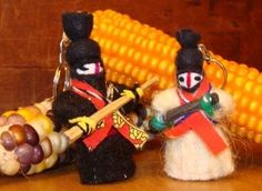 """Zapatista Doll Keychain // Show your solidarity with these Zapatista wool and wood doll keychains! Each measures between 2-1/2″ to 3″ high and features a """"fusil"""" as well as traditional dress and a recognizable red paliacate around the neck. The keychains have a short chain and a ring for attaching keys // 5 in stock // We ask that you pay whatever you can between $6 and $20."""