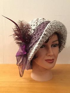 Thank you for looking at my Arcadia Flapper Style Hat pattern. This hat is made with Lion Brand Thick and Quick yarn. Stylish but still with warmth! It's styled to fit a circumference. Crochet Adult Hat, Crochet Beanie, Knitted Hats, Knit Crochet, Crochet Hats, Crotchet Stitches, Free Crochet, Flapper Hat, Flapper Style
