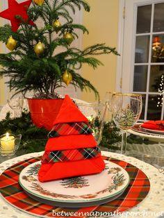 Christmas Table Setting with a Christmas Tree Napkin Fold