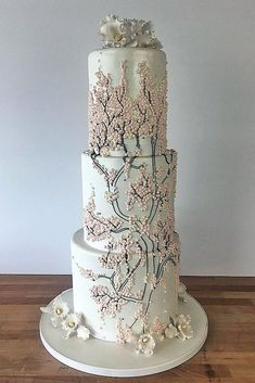42 Eye-Catching Unique Wedding Cakes � unique wedding cakes tall white with branches and pink mother of pearl charm city cakes via instagram #weddingforward #wedding #bride #bridalcake #uniqueweddingcakes