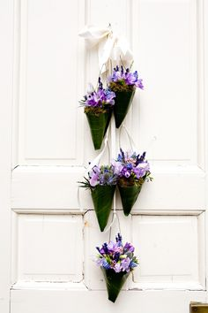 Flower cones of lavender and sweet pea on the door to the church  Photography by Christine Hall Photography, Floral design by http://www.harveydesigns.com
