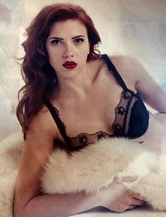 Natasha Romanova (Scarlett Johansson) as Natalie Rushman.