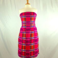"""NWT Banana Republic dress Never worn. Still has tag. 31.5"""" long. 30"""" waist. Strapless. Plastic gripping on back to keep dress from slipping. Boning inserted in top seams for support. Pink, orange, red, purple, white, and blue plaid pattern. Textured material. Dress pinned on mannequin for display. Banana Republic Dresses Strapless"""