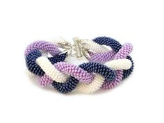 Bead crochet bracelet - Triple beaded bracelet - White purple blue bracelet - Seed beads jewelry  Statement bracelet crocheted by hand with thread and 3 different colors of Czech seed beads ropes: white purple blue.  Three bead crochet rope carefully waved to one and finished with silver caps into pretty bold and elegant bracelet. ◆MEASUREMENTS Length 8.3 in ( 21 cm ) Weight 0.1 lb ( 45 g )  Each purchase comes carefully packaged.  ◆Please note that real colors may slightly differ from their…