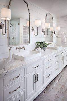 Shiplap bathroom wall with white cabinetry, white marble countertop, wall mount faucet and rustic looking floor tile. shiplap-bathroom-wall-with-white-cabinetry-and-rustic-looking-floor-tile Tracy Lynn Studio bathroom ideas Shiplap Bathroom Wall, Rustic Master Bathroom, Bathroom Renos, Budget Bathroom, Mirror Bathroom, Wooden Bathroom, Bathroom Remodeling, Bathroom Lighting, Remodeling Ideas