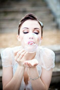 Bride Blowing Bubbles --- there will be bubbles at my wedding!