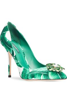 Swooning over these pointy toe pumps from Dolce&Gabbana! An emerald-tinted crystal flower glimmers atop this verdant banana-leaf print.