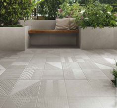 This contemporary patio has a grey tile from the Nux Collection. Great for indoor and outdoor use. There are different colors and styles available. Patio Tiles, Contemporary Patio, Grey Tiles, Porcelain Tiles, Outdoor Flooring, Rooftop Terrace, Tile Floor, Porch, Garage