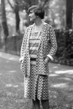 .Chanel wearing one of her suits whilst posing in the grounds of her home, 1929. During the 1920s Coco Chanel became the first designer to create loose women's clothing use jersey, traditionally used for men's underwear, creating a relaxed style for women ignoring the stiff corseted look of the time...