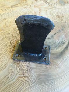 Axe head repurposed as kindling splitter.