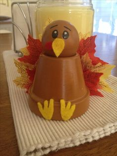 My vegetarian thanksgiving turkey =) Clay pot, doll head, paint, felt for for feet and beak, and fake fall leaves from the dollar store. Hot glue everything to together.