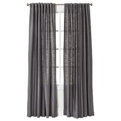 This charcoal grey panel, along with this sheer panel: http://www.target.com/p/nate-berkus-metallic-curtain-panel/-/A-14951492#prodSlot=_1_66