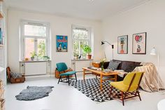 It is really cute, how the retro, colorful vintage chairs pops out in the otherwise mostly white...